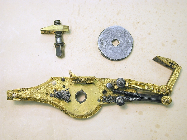 Wheellock mechanism for a pistol
