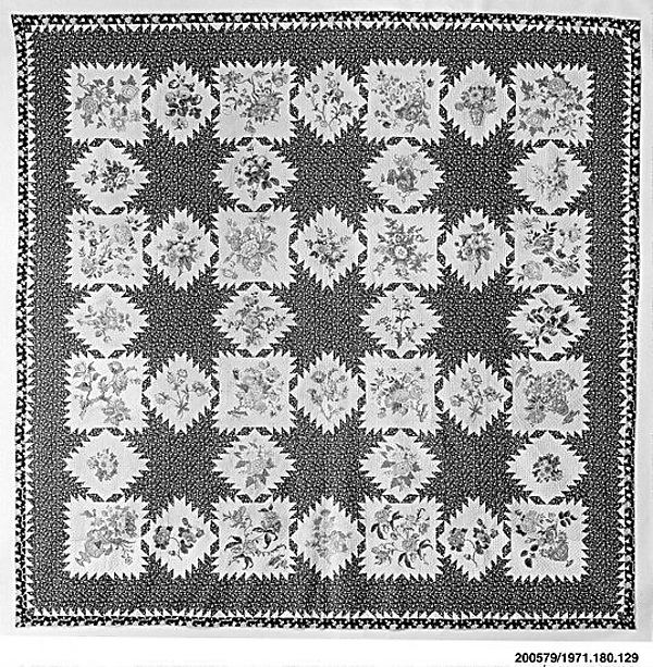Feathered Star pattern quilt with chintz appliques