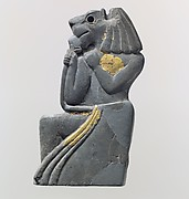 Plaque: kneeling lion-headed figure
