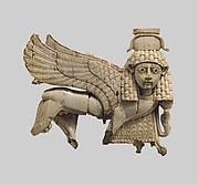 Openwork plaque with a striding sphinx