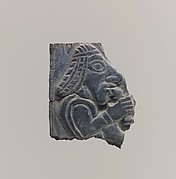 Plaque: man holding vessel to his mouth
