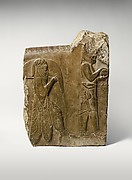 Relief: two servants bearing food and drink