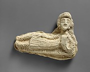 Plaque in the form of a reclining woman