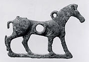 Horse bit cheekpiece in form of a striding horse