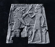 Plaque with a youth in an Egyptian double crown fighting a lion
