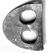 Fenestrated axe blade