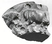 Fragment of a vessel with a bird of prey attacking a crouched animal in relief