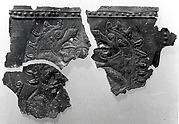 Fragments of plaque with fantastic creatures