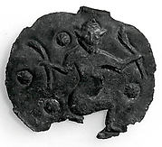 Pendant with a kneeling male