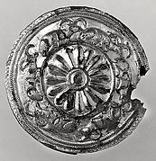 Roundel with a rosette and recumbent horned animals