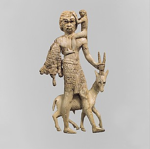 Tribute bearer with an oryx, a monkey, and a leopard skin