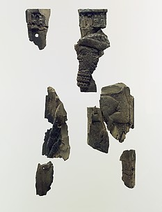 Plaque fragments with a bearded male dignitary carrying a young goat