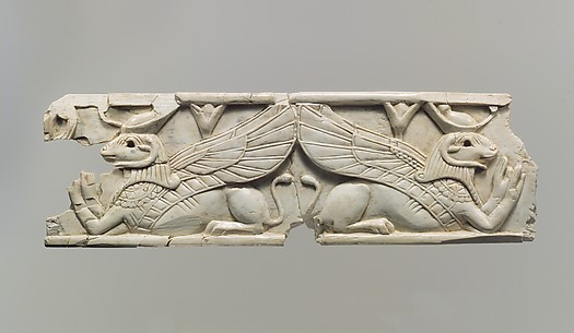 Plaque with reclining ram-headed sphinxes wearing the crown of Upper and Lower Egypt