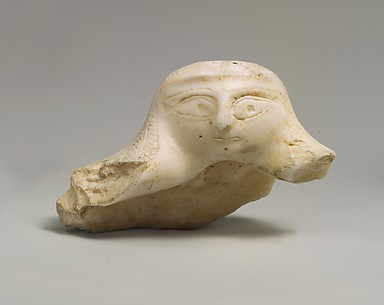 Fragment of a shell with a sculpted female head