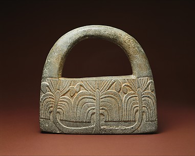 Object with a handle, perhaps a weight; palm trees and guilloche