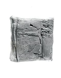 Cuneiform tablet case impressed with cylinder seal, for cuneiform tablet 11.217.7a: record of the account of Bamu