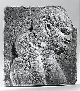 Relief: head and shoulders of a beardless man, possibly a eunuch