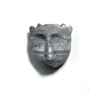 Demon-headed amulet