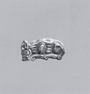 Inlays for a silver plate in the form of a hare and a feline