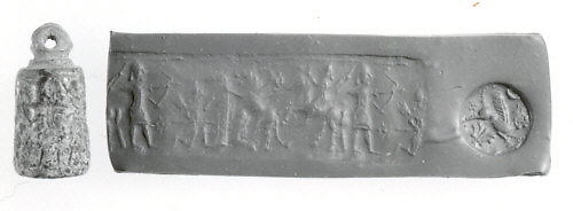 Stamp-cylinder seal: hunters and a lion