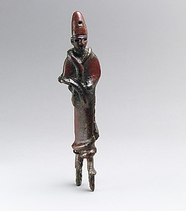 Royal or divine figure with high conical headdress