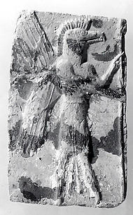 Molded plaque: eagle-headed apkallu