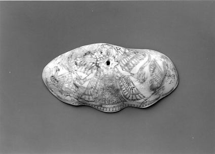 Shell engraved with winged female deity, sphinxes, and lotus plants