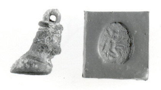 Bull's hoof stamp seal and modern impression: kneeling winged genius