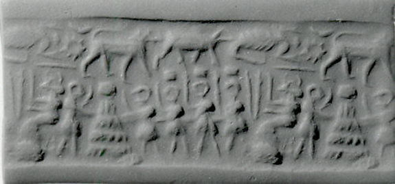 Cylinder seal and modern impression: seated goddess before figures carrying boxes, one placed on