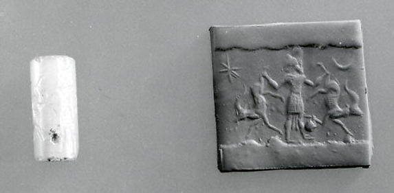 Cylinder seal: hero grasping two antelopes by their hind legs