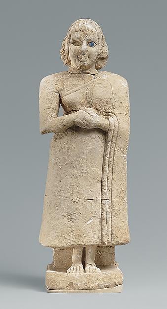 Standing female worshiper
