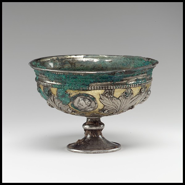 Footed cup with human busts in medallions