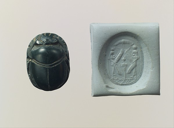 Scarab seal: Osiris flanked by protective deities
