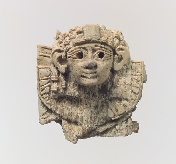 Openwork furniture plaque with head of a sphinx