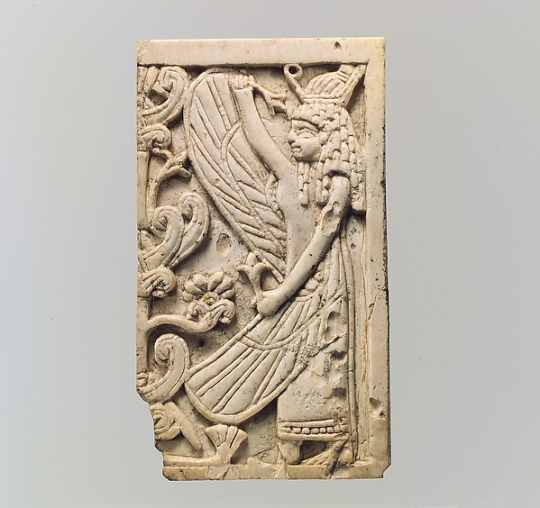 Plaque with a winged female and a sacred tree