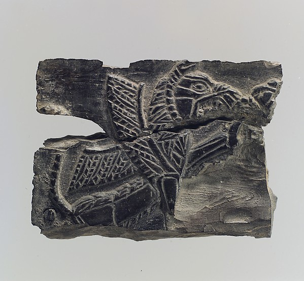 Plaque with a seated, winged leonine monster  possibly with scorpion tail