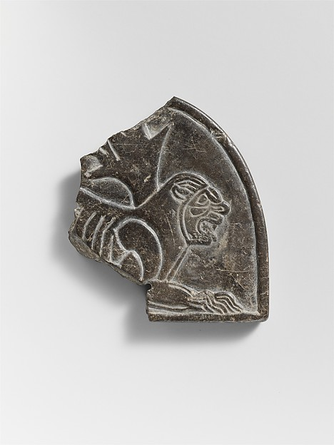Plaque with the figure of a lion