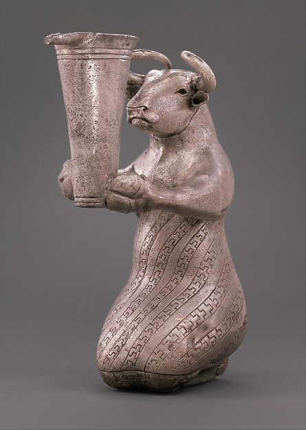 Kneeling bull holding a spouted vessel
