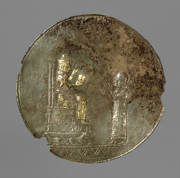 Medallion with a seated deity and a male worshiper