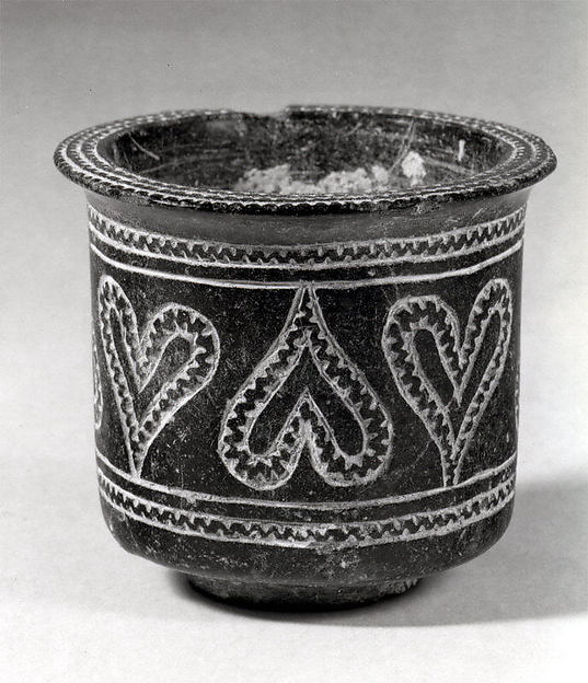 Cup with incised decoration