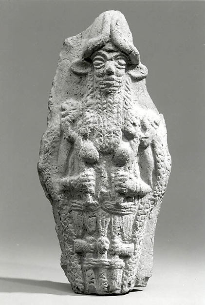 Molded plaque: bearded underworld god