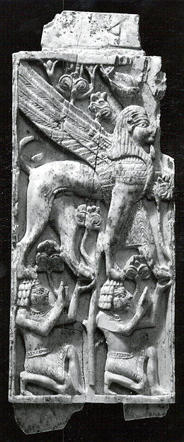 Plaque with two kneeling figures supporting a striding sphinx