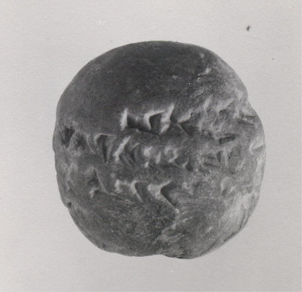 Inscribed clay ball