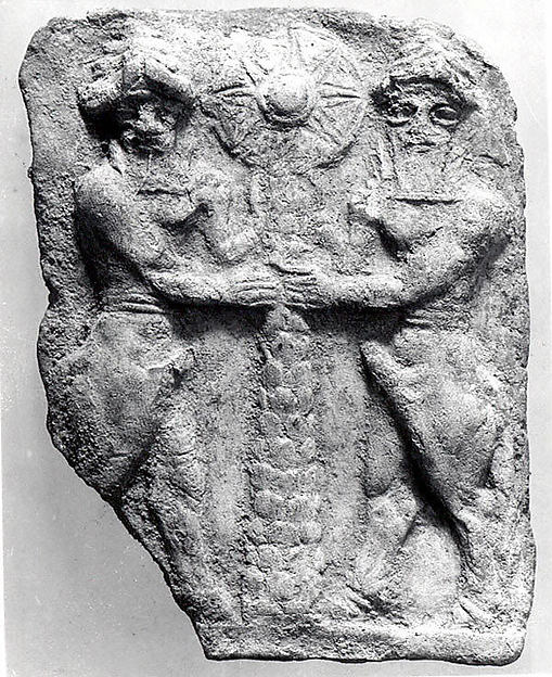 Molded plaque: bull-men flanking a tree trunk surmounted by a sun disc