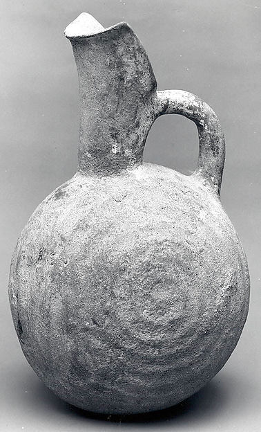 Spouted jug with raised concentric circles