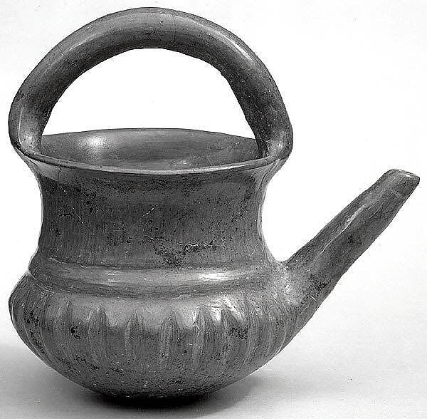 Spouted jar with a basket handle