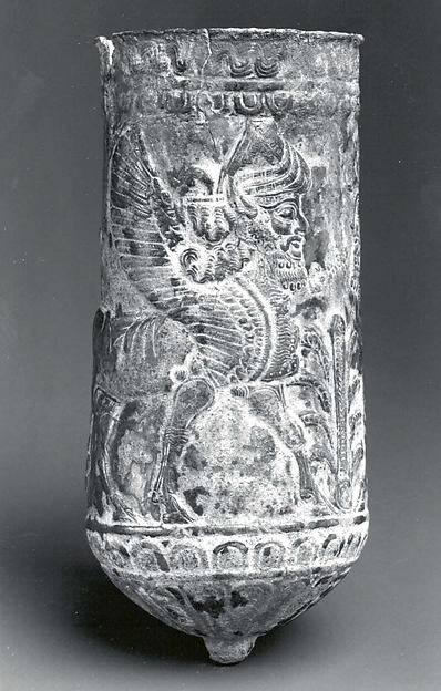 Beaker with winged human-headed bulls flanking a stylized tree