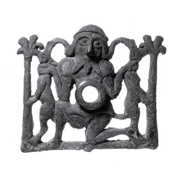 Horse bit cheekpiece in form of a kneeling hero