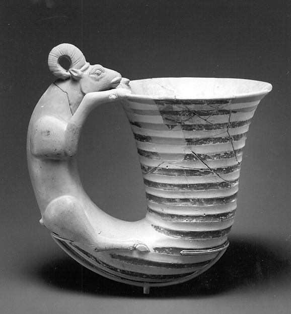 Vessel with a handle in the form of a ram
