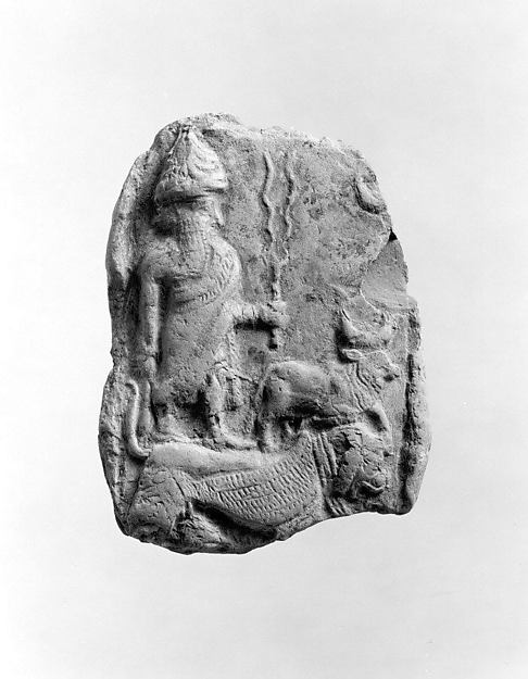 Molded plaque: the weather god Adad and a bull standing on a lion-dragon